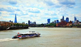 Thames River cruise boats London skyline England stock photo