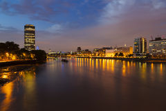 Thames River In London At Night. View from Vauxhall Bridge to the center of London at night Royalty Free Stock Images