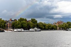 Thames river and some houses. A photo of the river Thames, boats and houses. Trees and skies. Amazing wallpaper stock photo