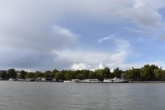 Thames river and some houses. A photo of the river Thames, boats and houses. Trees and skies. Amazing wallpaper stock images