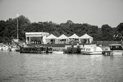 Thames river in Windsor reporting live Prince wedding. WINDSOR, BERKSHIRE, UNITED KINGDOM - MAY 19, 2018: Media TV stations tents near Tamisa river reporting Stock Image