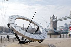 Thames Sun Dial. A Sun dial clock at Tower Bridge on the bank of the Thames with Tower Bridge in the back ground. Picture is good to show location sights and royalty free stock image