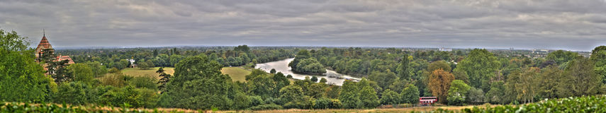Thames through Twickenham HDR. A panaramic veiw from just outside Richmond Park looking over the Thames, Twickenham and Heathrow airport stock photography
