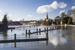Thames weir at Marlow in full flood. View of the weir at Marlow during a period of full winter flooding when the river Thames is at its highest level Royalty Free Stock Photos