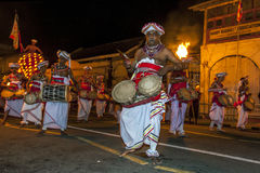 A Thammattam Player (centre) leads a group of Davul Players performing at the Esala Perahara in Kandy, Sri Lanka. Royalty Free Stock Image