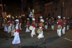 Thammattam Players left and Davul Players right perform through the streets of Kandy during the Esala Perahara in Sri Lanka. Stock Image