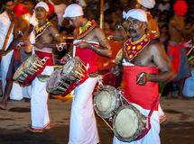 Thammattam Players perform along the streets of Kandy during the Esala Perahera in Sri Lanka. Stock Photo