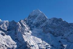 Thamserku mount in Sagarmatha National park, Nepal Himalayas. Thamserku mount, elevation 6623 m in Sagarmatha National park, Nepal Himalayas Stock Photo