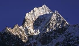 Thamserku Mountain Top Nepal Himalaya Mountains Everest Base Camp. Thamserku Mountain Peak in Nepal Himalaya Mountains on hike to Everest Base Camp stock photo