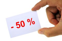 Less than 50% in closeup. Closeup hand-drawn card on which is written Less 50 stock photos