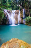 Than sawan Waterfall, Paradise waterfall in Tropical rain forest of Thailand , water fall in deep forest at border of Chaing rai a Royalty Free Stock Images