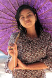 Thanaka on the face, umbrella over the head Stock Photo