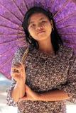 Thanaka on the face, umbrella over the head Stock Photo