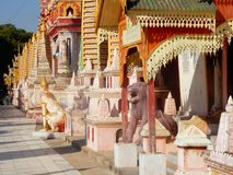 Myanmar, Thanboddhay monastery, exuberant colored and decorated with small pagodas, Buddhist temple images royalty free stock images