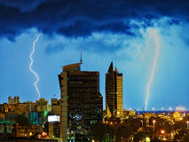 Thanderstorm over night city. Royalty Free Stock Photography