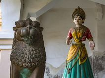 Thanjavur Dancing Doll and a Bronze Lion. The Thanjavur doll is made of terracotta. It is a type of traditional Indian bobblehead or roly-poly toy. The centre of royalty free stock images