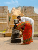 THANJAVUR, INDIA - FEBRUARY 13: Indian man and woman  in nationa. L costumes commit ritual actions  in Gangaikonda Cholapuram Temple. India, Tamil Nadu Royalty Free Stock Photography