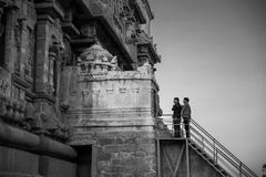 Thanjavur, India - February 23, 2017: 2 Indian men praying at Br. Ihadisvara Temple royalty free stock photos