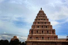 Bell tower of the thanjavur maratha palace with sky. The Thanjavur Maratha Palace Complex, known locally as Aranmanai, is the official residence of the Bhonsle royalty free stock image