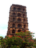 The thanjavur maratha palace tower with tree. The Thanjavur Maratha Palace Complex, known locally as Aranmanai, is the official residence of the Bhonsle family stock image