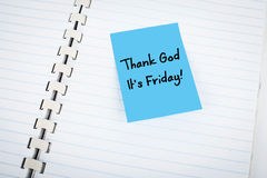 Thank God it is Friday. Blue Thank God it's Friday note taped on notebook royalty free stock photography
