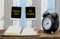 Thank god , It's Friday on paper note Royalty Free Stock Photos