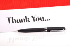 Thank you. Pen on white - showing thank you text against red stock images