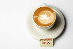 Thank you!. Barista coffee cup with thanks note Stock Image