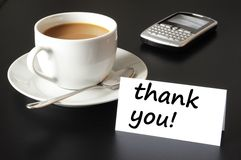 Thank you. Or thanks concept with cup of coffee on black background royalty free stock image