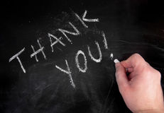 Thank you. Hand writing thank you on a blackboard stock photo