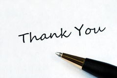 Thank You. Ball pen on white background showing Thank You Stock Image