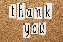 Thank You. In cut out letters pinned to a cork notice board stock image