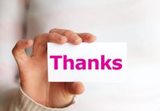 Thank you. Or thanks concept with hand word and paper Stock Photography
