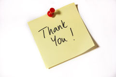 Thank you. Written on a sticky note Royalty Free Stock Photography