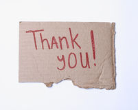 Thank you!. Isolated on white: ripped cardboard with red sign (Thank you Stock Photos