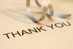 Thank you. Close up of silver ribbon on thank you text royalty free stock images