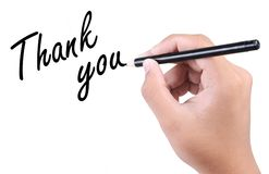 Thank you. Right hand writing thank you on white background Royalty Free Stock Images