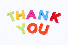 Thank you. Fridge magnet spelled out thank you isolated on white Stock Photos