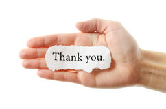 Thank you. Or thanks concept with hand word and paper. Isolated on white background Royalty Free Stock Photo