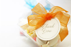 Thank You. A candy box tied with an orange ribbon with a circle thank you label.  A token of thanks Stock Image