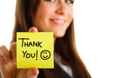 Thank you. Business woman showing a post-it to thank you Royalty Free Stock Photos