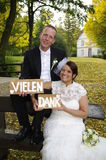 Thank you - Vielen Dank. Wedding couple in vintage Dress says thank you, picture for a thank-you card, Vielen Dank - german wedding, autumn scenery stock image