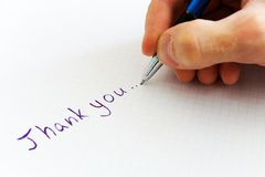 Thank you. Handwritten thank you on white paper stock photography