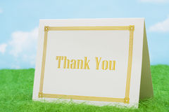 Thank You. Card on grass with sky background stock photo