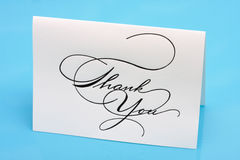 Thank You. Card on a blue background stock images