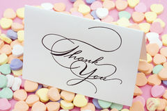 Thank You. Card on candy heart background stock photo