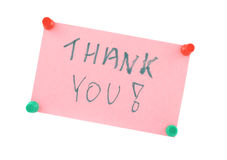 Thank You. Pinned pink paper note with handwritten THANK YOU words. Background is pure white royalty free stock images