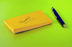 Thank you. Note of thanks on a sticky Stock Photo