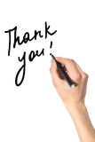 Thank you. Right hand writing thank yoy on white background stock photos