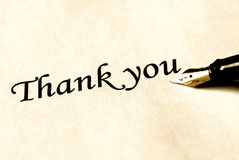 Thank you. Thank ou writing and fountain pen on white paper - old sepia style stock photo